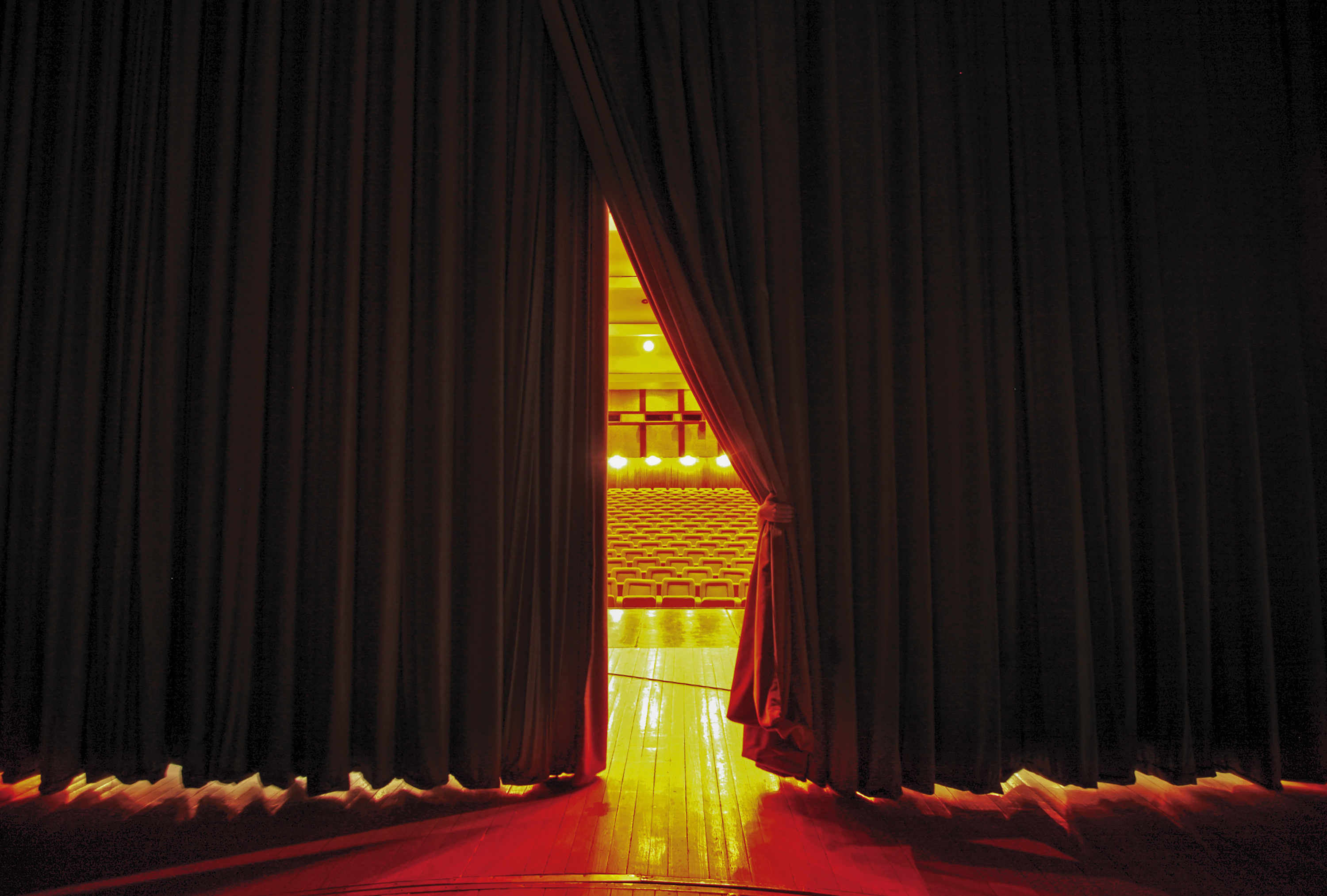Theater seats through curtains